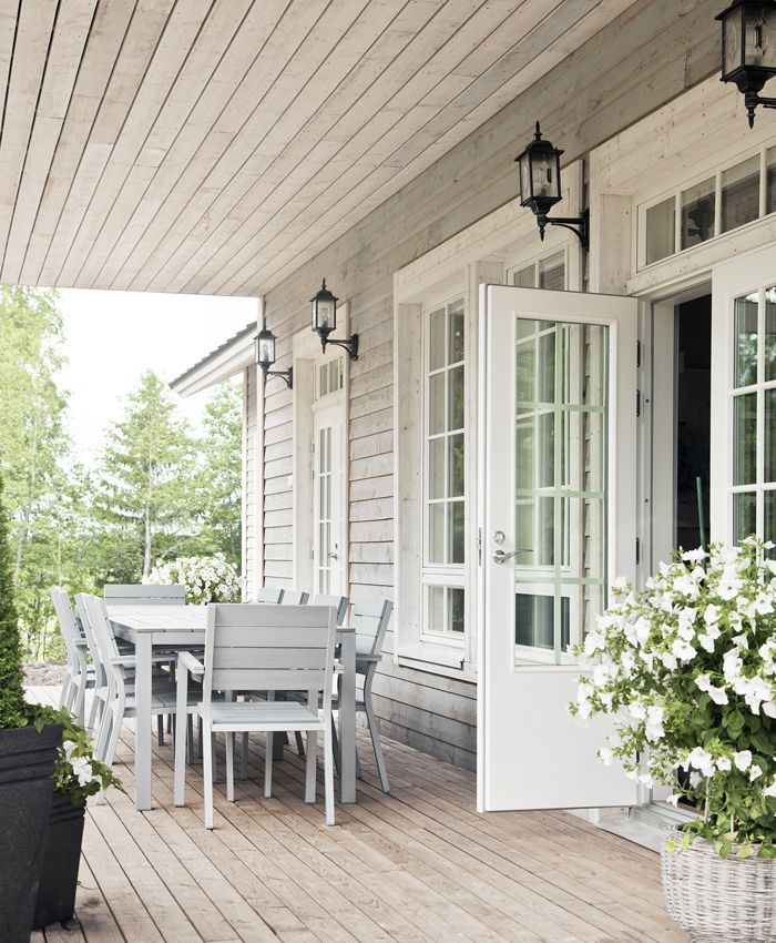 Great porch!! Windows, doors, light fixtures. Silvery-gray wood with white windows.