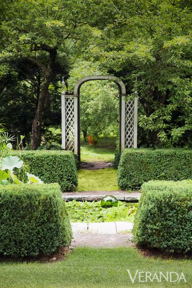 """When designer Bunny Williams first conceived the garden at her country house in Litchfield County, Connecticut, it was nothing more than a bed for vegetables and blooms. """"I chose a sunny spot and had it plowed,"""" she says of the property she now shares with her husband, the antiques dealer John Rosselli. Paths, hedges, and architectural features such as a lattice archway define Bunny Williams's garden.   - Veranda.com"""