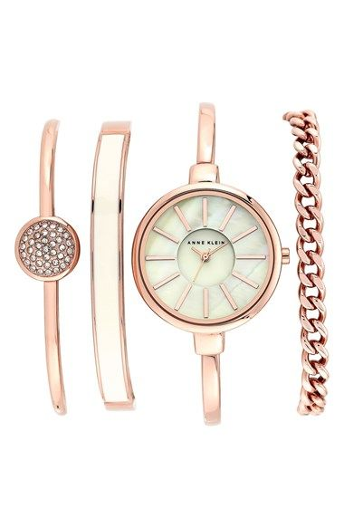 Anne Klein Round Watch & Bangle Set, 32mm at Nordstrom.com. A clean round bangle watch is paired with a set of coordinating bracelets for a cool, ready-to-go stacked wrist.