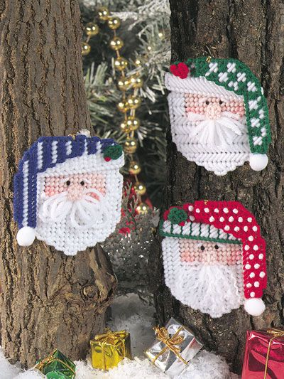 Santa Faces Ornaments Plastic Canvas Pattern Download from e-PatternsCentral.com -- Stitch a trio of adorable ornaments showing Santa in his holiday hats!