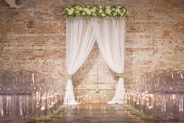 A loft ceremony is made all the more magical with Lucite chairs and moss green accents.Plus, check out Wedding Inspiration for an Urban Affair ►Photo Credit: Blueberry Creative on Inspired by This via Lover.ly