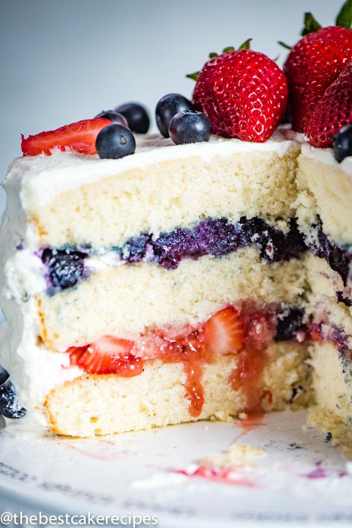 3 layers of white cake with blueberry and strawberry
