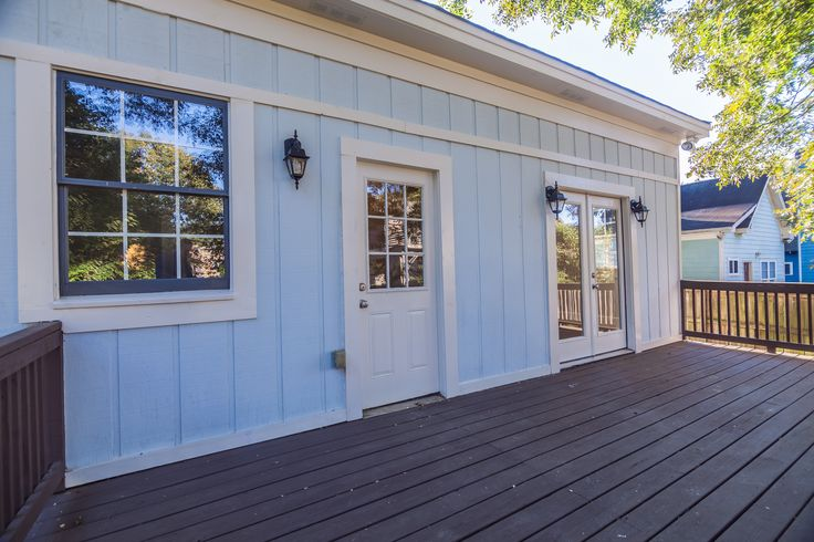 Sherwin Williams SW 6519 - Hinting Blue & Trim Color is Sherwin Williams SW 7028 Incredible White & Minwax Stain Provincial on the deck