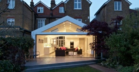 A contrasting contemporary kitchen extension, with a unique glass gable feature within the roof construction. | Plus Rooms