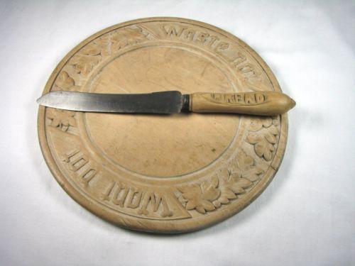 11.75in across. 'Waste Not, Want Not' Antique Primitive Wooden Folk Art Carved Bread Cutting Board & Knife Nice Patina. Realized 331.99  on Jan 08 2013 ebay
