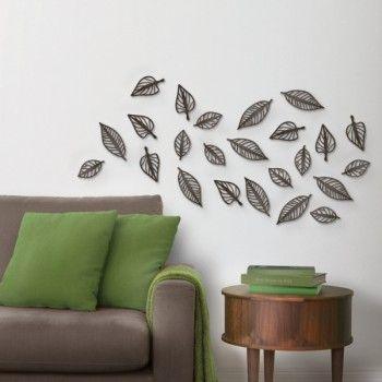 Zestaw 24 listków Natura holenderskiej marki Umbra. Produkt został wykonany z tworzywa sztucznego. Każdy z elementów można rozmieścić na ścianie w dowolny sposób. Tego rodzaju dekoracje ścienne nadają odpowiedni charakter wnętrzu.