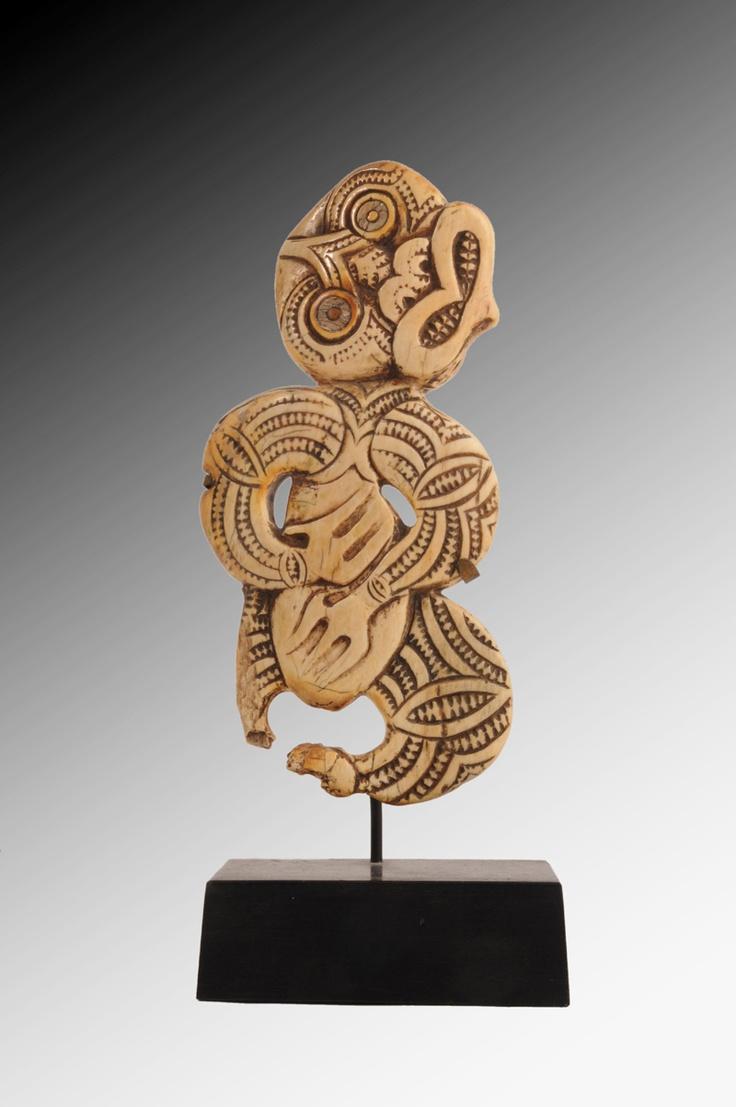 A Maori Bone Tiki, New Zealand, probably by J.Robieson
