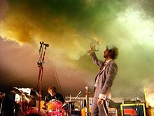 The Flaming Lips are an American rock band, formed in Oklahoma City, Oklahoma in 1983. Instrumentally, their sound contains lush, multi-layered, psychedelic rock arrangements, but lyrically their compositions show elements of space rock, including unusual song and album titles.