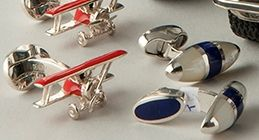 Red bi-planes, silver & enamel cufflinks from Belmont Jewellers, and classic bullet-shaped silver, lapis lazuli & mother-of-pearl cufflinks from Wolfe Jewellery @ silvervaultslondon.com