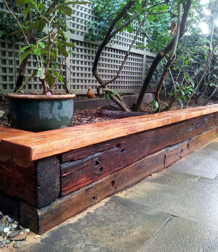 Stained railway sleeper garden bed home design for Garden designs sleepers