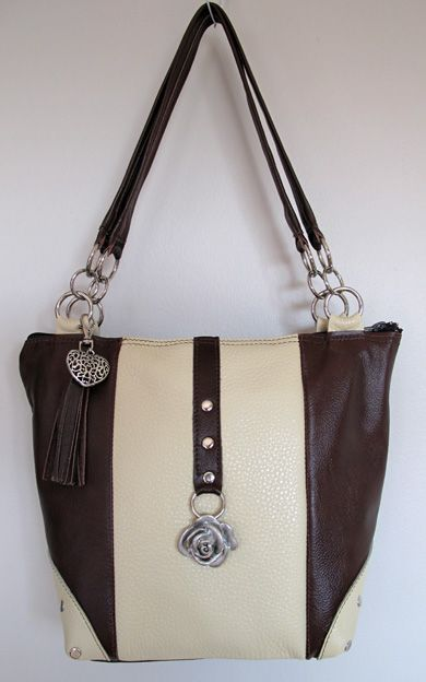 Dark brown and crème leather with rose