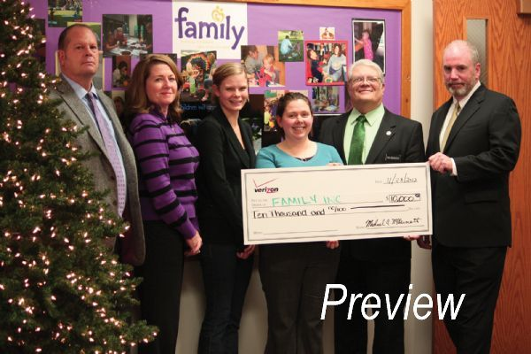 Staff Photo/Kirby Kaufman  FAMILY, Inc., received a $10,000 grant Wednesday from the Verizon Foundation to support victims of domestic violence. The money will fund services, which include home visits, parenting classes and legal clinics. The goal is to empower victims of domestic violence in Pottawattamie County and help them become self-sufficient, said Kate Gronstal, community engagement coordinator for FAMILY, Inc.