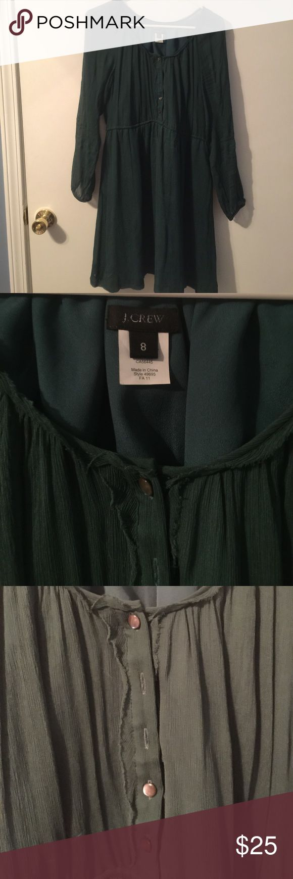 J. Crew Forest Green midi dress with sheer sleeve Size 8 J.Crew A-lined dress with pockets. The stress is in a beautiful forest green color with cinched waist. The sleeves are sheer and also buttoned as pictured. The dress is missing two buttons as shown and I found one of the buttons however was unable to locate the other so I found one similar that is also J.Crew and will be happy to send that as well. I wore this dress with boots in the fall and it was adorable. Only selling because it is…