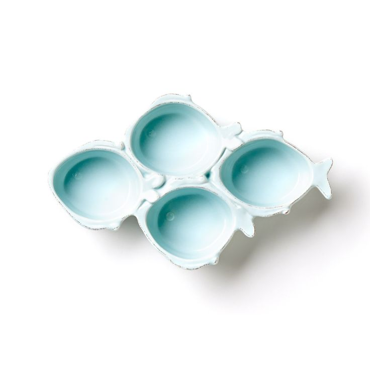 The Lastra Fish Aqua Four Part Server combines the charming shapes of Lastra Fish with the popular hue of our larger Lastra Aqua collection. Delight those in your home with these four swimming fish as you serve nuts, olives, and other bite-sized treats.