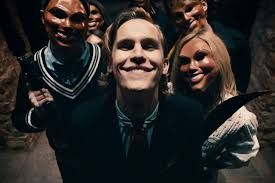Rhys Wakefield and masked Purgers.