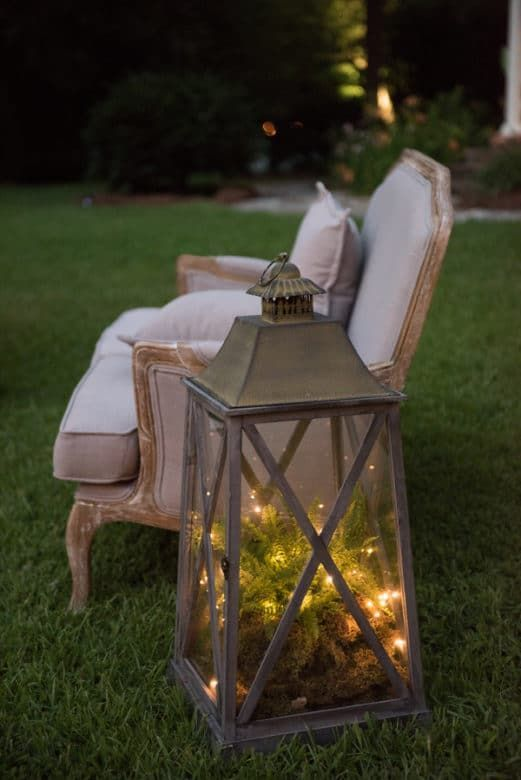 large lanterns filled with moss and fairy lights- could be used as outdoor decor or near the fireplace