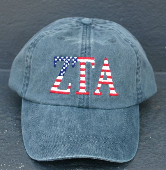 Pictured is a Navy cap with Zeta Tau Alpha letters with the USA flag design. The letters are embroidered. You can choose from other cap colors with
