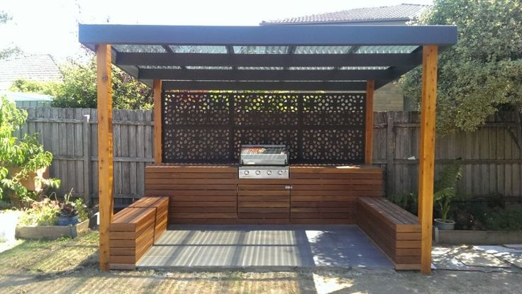 Built in bbq with timber cladding and bench seats