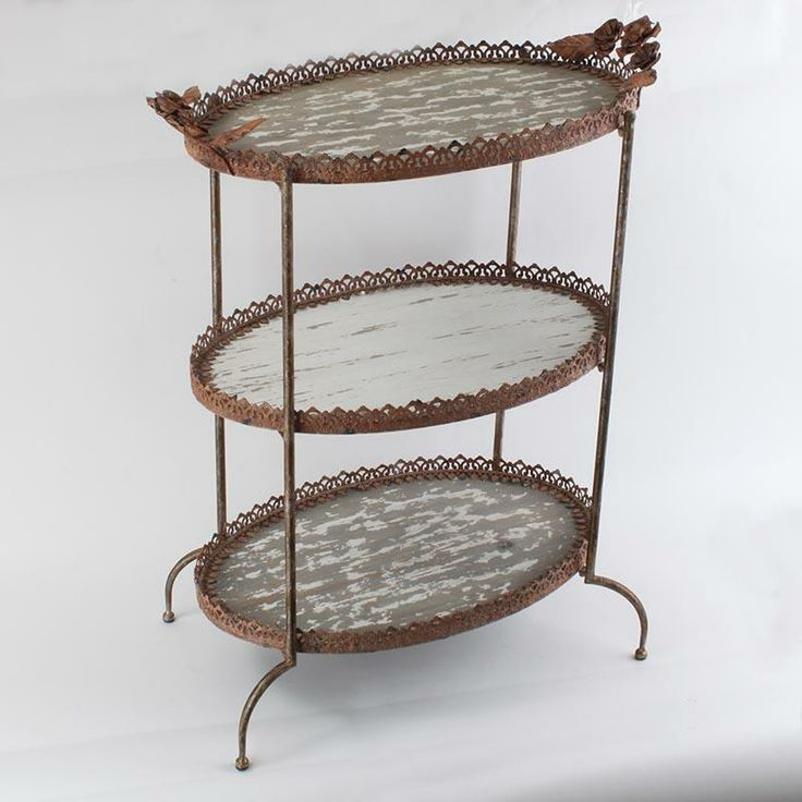 Wooden three tier table in antique white/grey color and metal details in gold color.