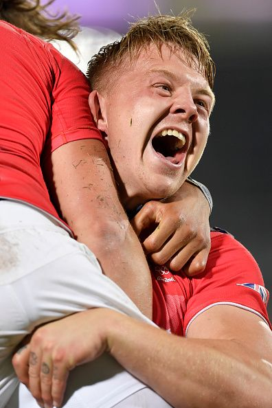 Britain's James Davies lifts up with teammate Dan Bibby after he scored the…