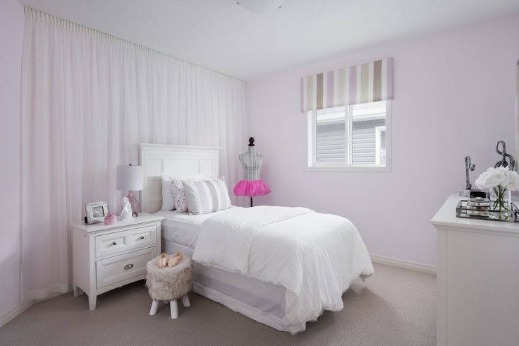 Secondary bedroom in Shane Homes Tofino II Showhome in Redstone in northeast Calgary #bedroom