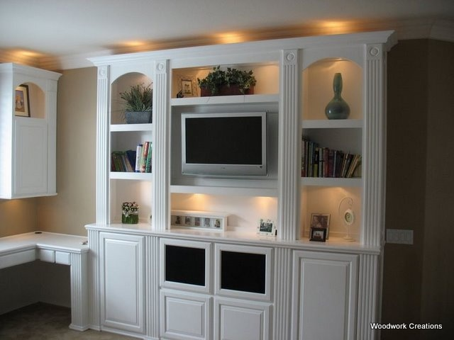built in entertainment center...saves space and is a permanent structure...:)