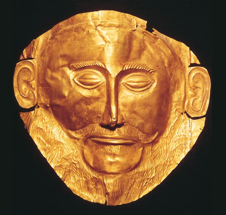 "Funerary Mask from Grave Circle A  Date: 1600-1500 BCE Location: Mycenae, Greece Culture: Mycenaean Medium: Beaten Gold Notes: First attempt at life size sculpture in Greece. Home described the Mycenaeans as ""rich in gold""."