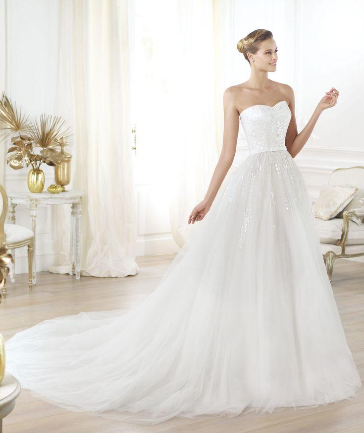 Pronovias presents the Layna wedding dress. Glamour 2014. | Pronovias Very 'winter wedding', but i think i prefer lace over beading.  Do not like belt