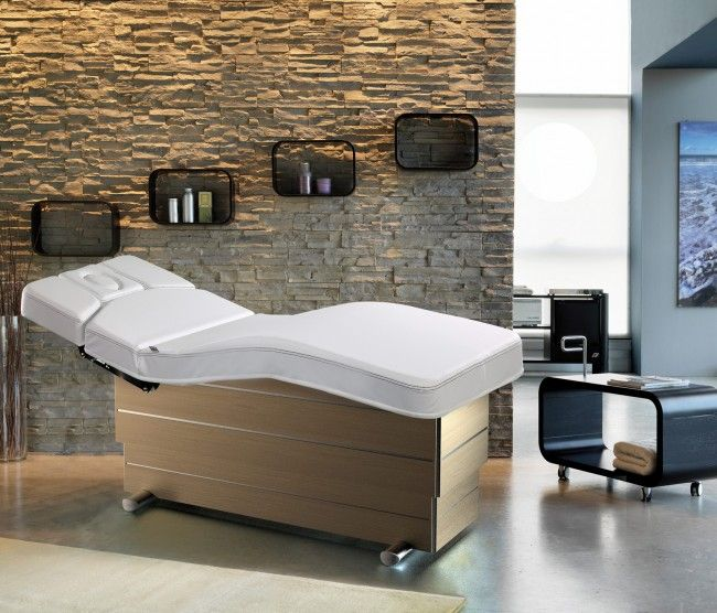 Versus Ergonomic Spa Treatment bed. Oak finish base and white upholstery.