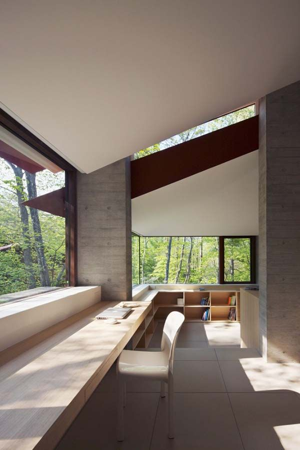 Contemporary hilltop residence surrounded by forest in Japan