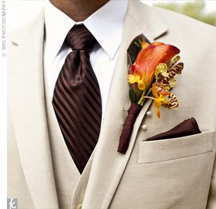 Beige Tux, Chocolate tie, and orange flower.  Would be gorgeous for a fall wedding
