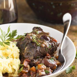 Beef short ribs are browned on the stove and then oven braised for hours in red wine until they are meltingly tender in this recipe for french short ribs.
