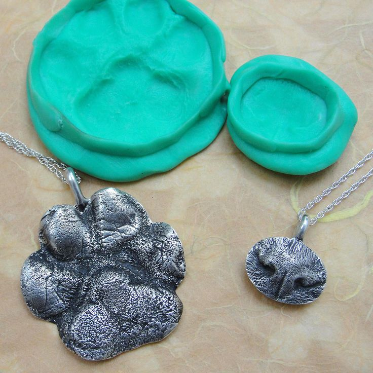 Custom-made necklaces from your pet's nose or paw. Names imprinted on back.