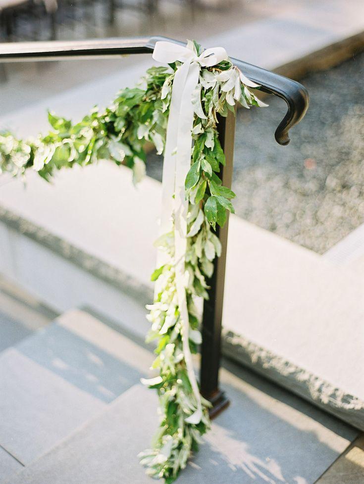 greenery garland on stair railing gardens wedding