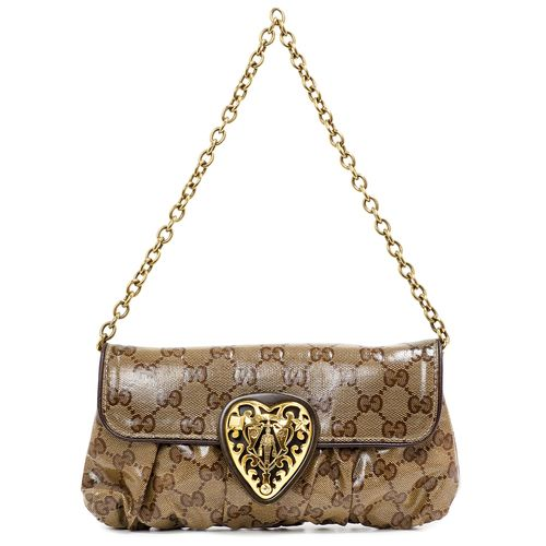 """Authentic Gucci GG Crystal Coated Canvas Babouska Heart Clutch  CONDITION: Very good. Light scuffs on hardware, faint wear on leather trim.  Material: Crystal coated canvas Color: Beige, brown Exterior Features: Front magnetic snap closure, chain shoulder strap, gold tone hardware  Interior Features: Dark brown Gucci signature lining, open pocket Measurements: 9"""" x 5"""" x 1"""" SKU: HA02087"""