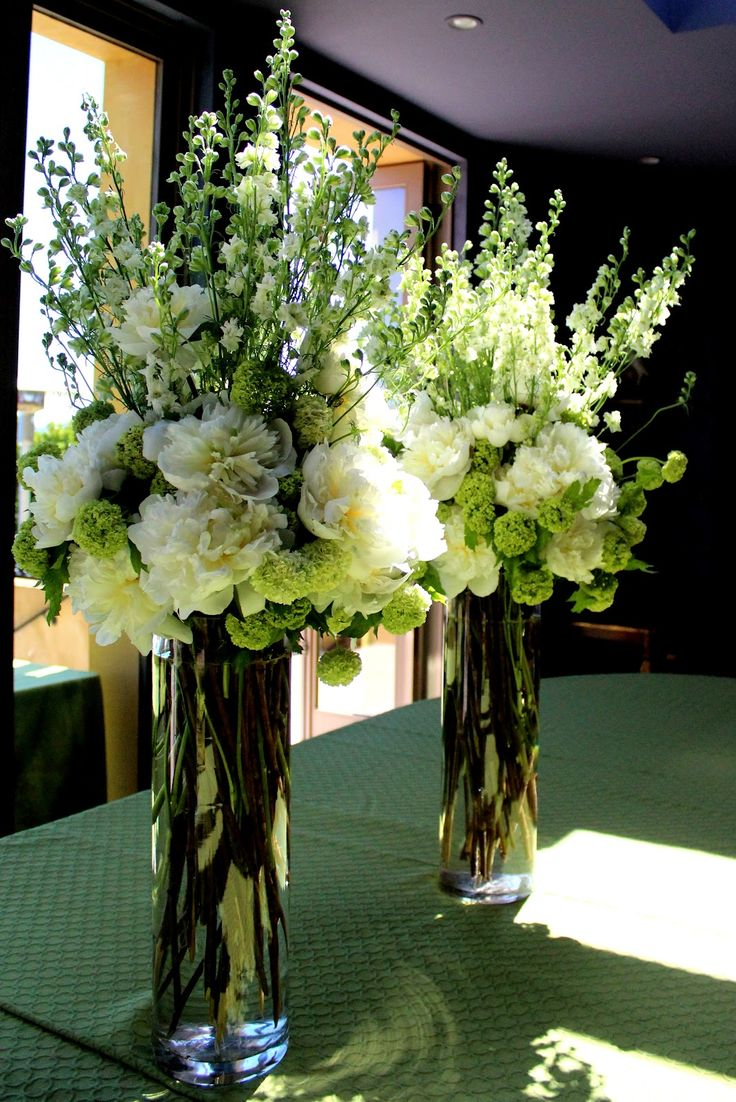This is gorgeous for a spring wedding.  White, green, pops of coral Tall Flower Arrangements For Weddings | The elegant tall centerpieces inside the home had white peonies, green ...