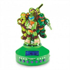 Let your child wake up in a super mood with the Teenage Mutant Ninja Turtles clock/radio. It features vibrant, hi-resolution turtle figures and durable construction to stand up to most adventures. Features a digital display so kids can read the time with ease. Digital alarm clock with radio AM/FM radio, digital display, wake to music, volume control All four Teenage Mutant Ninja Turtles are featured on top Requires 6 'AAA' batteries, not included Ages 7 years and up