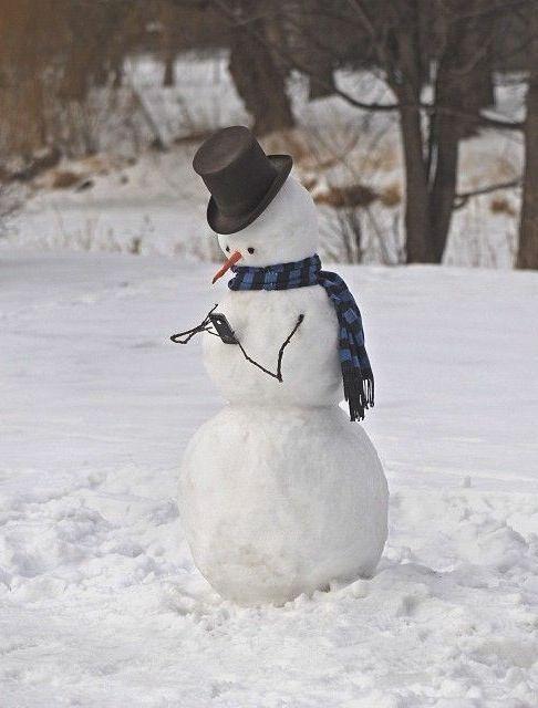 Modern snowman busy on the phone