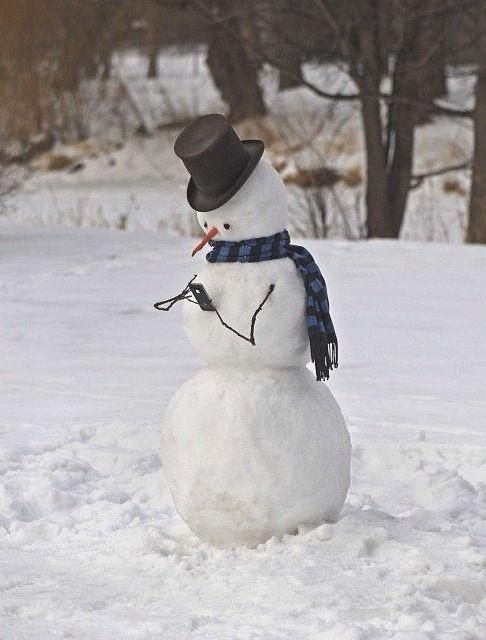 Modern snowman busy on the phone