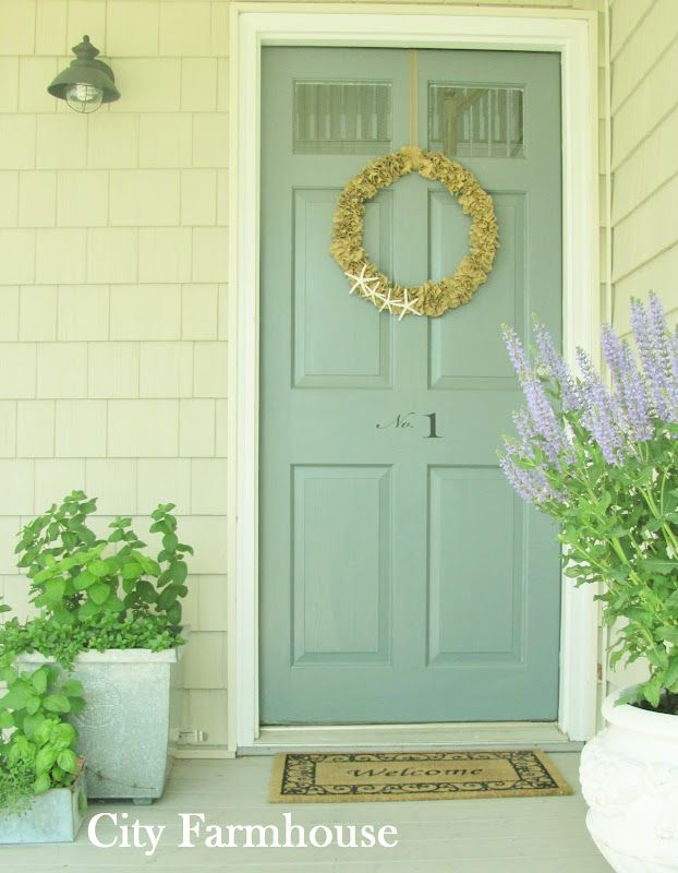 Love this front door color!   Hmmmm . . . Maybe would do a couple shades darker though.