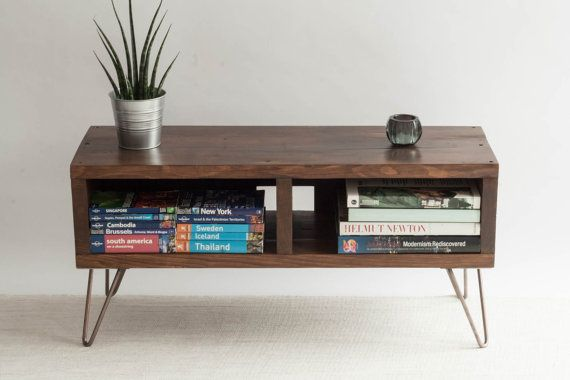 This industrial style TV stand is made from reclaimed wood with 20cm metal hairpin legs. It has a full width opening from the front with