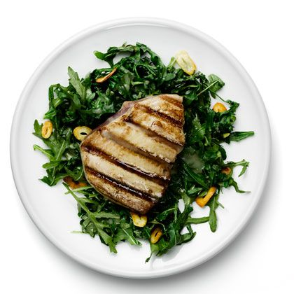 A satisfying zero carb dinner: Heart-healthy tuna on a bed of garlicky braised arugula | health.com