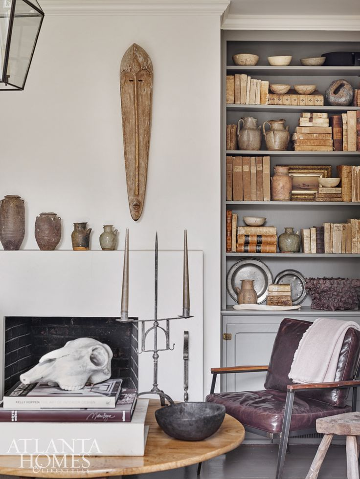 A collector in every sense of the word, Debbie has mastered the art of display in the den bookcase with her eclectic, character-rich personal collections.