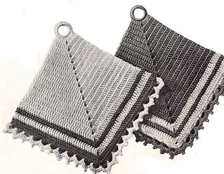 Two mitred potholders with lace edging on two edges