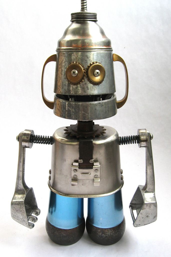 https://flic.kr/p/6Gq3v5 | Cubic - Robot Sculpture | Robot sculpture assembled from found objects by Brian Marshall - Wilmington, DE. Items included in my sculptures vary from vintage household kitchen items to recycled industrial scrap. Some of my favorite items to use are old oil cans, aluminum measuring spoons, electrical meters, retro blenders, anodized cups, and pencil sharpeners.