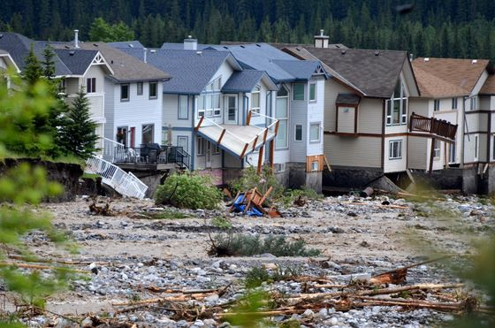damaged homes - Cougar Creek, Canmore