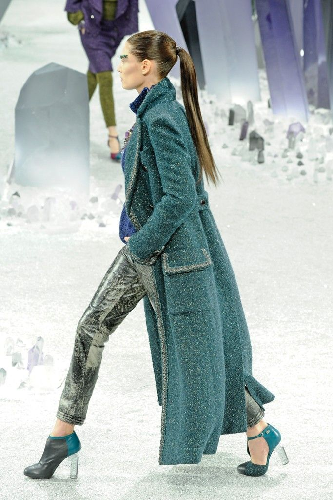Love the color and long coat over slim pants. Can't wear those beautiful heels in the snow, but it's a fantasy, not a city street. - Chanel RTW Fall 2012