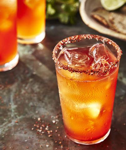 Michelada | A michelada is simply a way to take your favorite lager-style beer in a more savory direction. We like to use Corona or Pacifico for the slightly tropical vibes but your favorite American session beer should work just fine. Tajín is a Mexican spice blend consisting mostly of chili powder, lime, and salt. If you can't find it, combine equal parts crushed red pepper flake and lime zest and season to taste with salt. Use it to rim glasses for a spicy take on margaritas, micheladas…