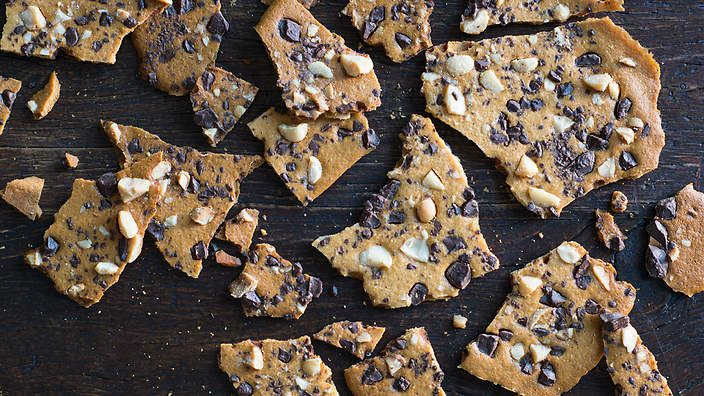 They mightn't look like your average cookie, but these chocolate and macadamia wafers from Anneka Manning are wonderful with a cup of coffee or tea. Play with the chocolate and nut combination to suit your tastes. Check out our Bakeproof column for tips and recipes.