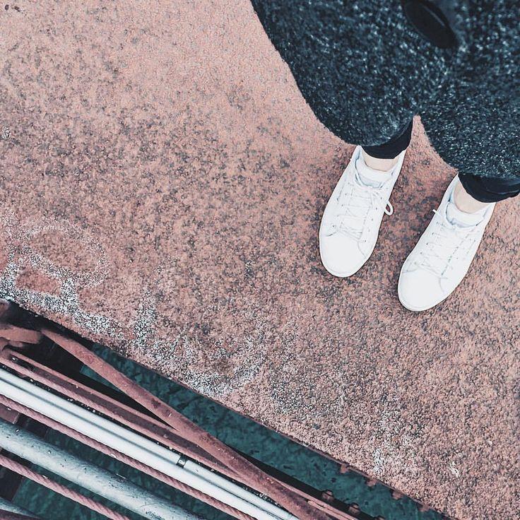 White shoes on red floor. #fromwhereistand #shoes #whiteshoes #bridge #ihavethisthingwithfloors #lyon #floor #redfloor #lecoqsportif #city…